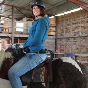 Personne à mobilité réduite sur un cheval